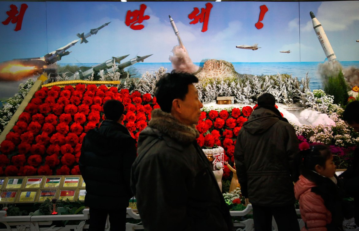 "Thousands of Pyongyang residents attended Monday's opening of an elaborate flower exhibit featuring a bright-red begonia named ""Kimjongilia"" as well as the Kwangmyongsong rocket model. [Wong Maye-E/AP]"