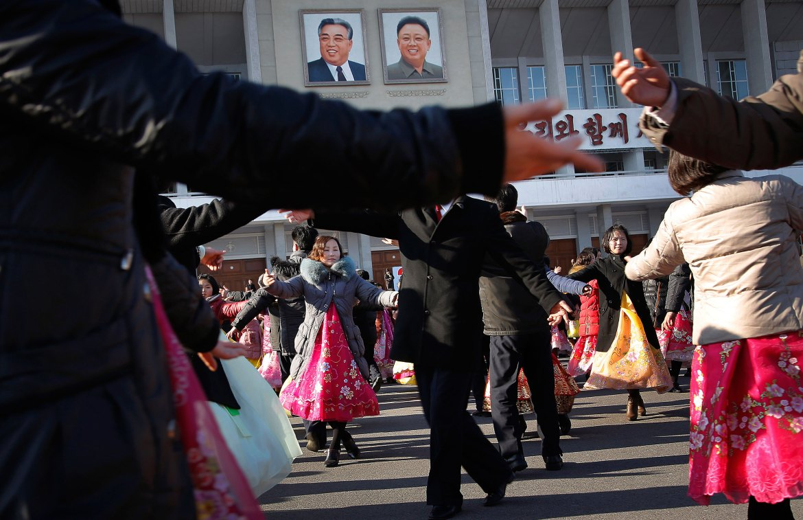 North Korean men and women participate in a mass dance party as part of the birthday celebrations. [Wong Maye-E/AP]