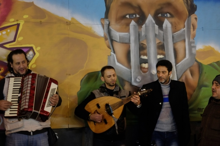 Musicians from Syria play Arabic songs for money in central Istanbul's Istiklal Avenue [AP]