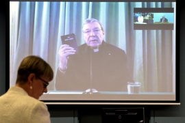 Pell was sworn in to give evidence, via video link, in front of victims in a Rome hotel room [Reuters]