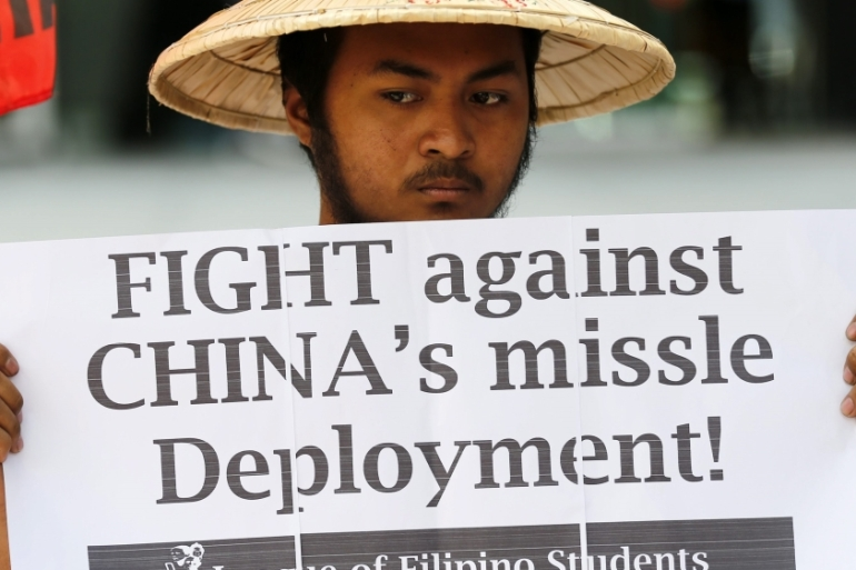 Filipinos protest reports that China deployed a surface-to-air missile system in the South China Sea [Francis R Malasig/EPA]