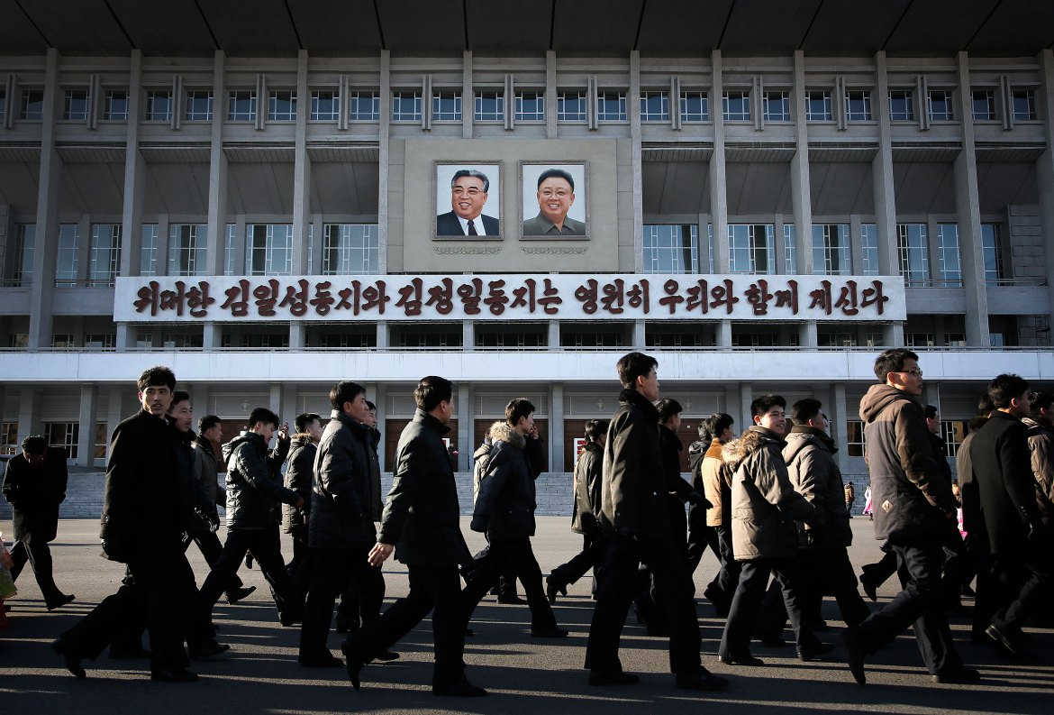 Portraits of the late leaders Kim Il Sung, left, and Kim Jong Il, right, are displayed over words that read: 'The Great Kim Il Sung and Kim Jong Il will always be with us.' [Wong Maye-E/AP]