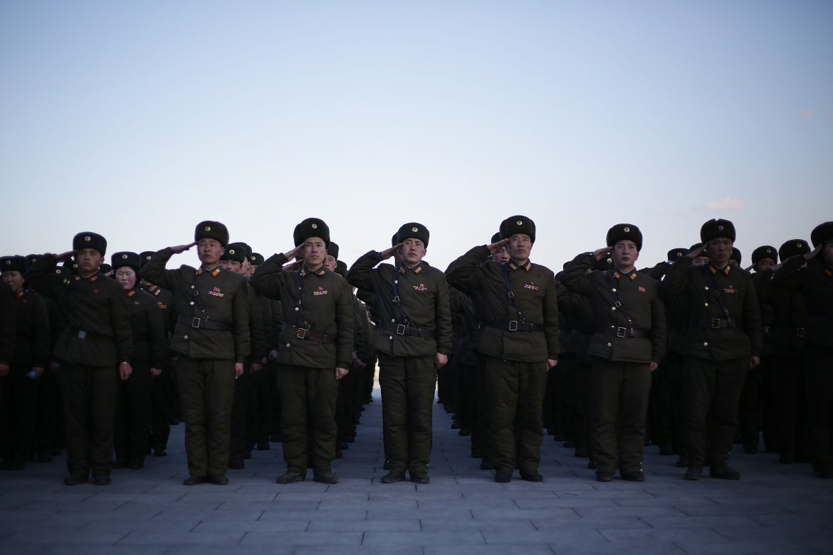 North Korean soldiers gather at Munsu Hill to offer flowers. [Wong Maye-E/AP]