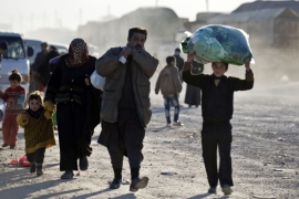 Turkey says thousands of Syrians have massed on the Syrian side of the border seeking refuge in the past few weeks [AP]
