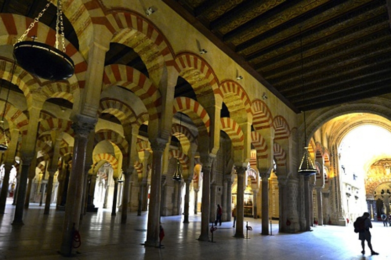A tourist visits the Mosque-Cathedral of Cordoba [AFP]
