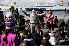 Syrian refugees shout slogans during a protest march in the port of Piraeus in Athens [EPA]
