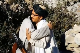 A seven-minute video, released by the media arm of the Pakistan Taliban, shows Mufti Abu Zar al-Burmi, right, standing alongside Umar Mansoor, left, and embracing him [Video still]