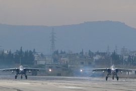 Two Russian Sukhoi Su-24 bombers at the Russian Hmeimim military base in Latakia, Syria [Getty]