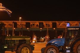 Tractors block a toll post on the highway linking Athens to Korinth [John Psaropoulos/Al Jazeera]