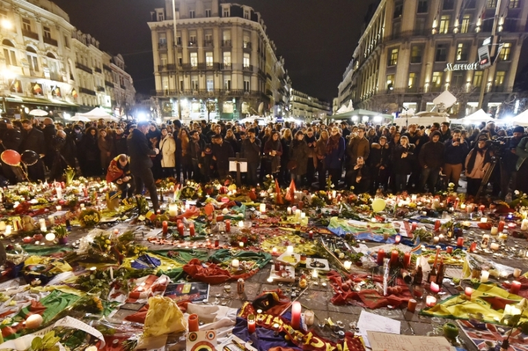 Hundreds of people come together at Place de la Bourse in Brussels to mourn [AP]