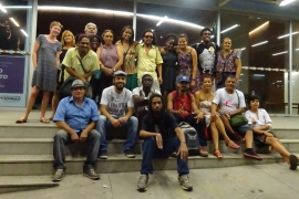 Poets and performers pose for a photo after Sarau do Binho [Kathleen McCaul/Al Jazeera]