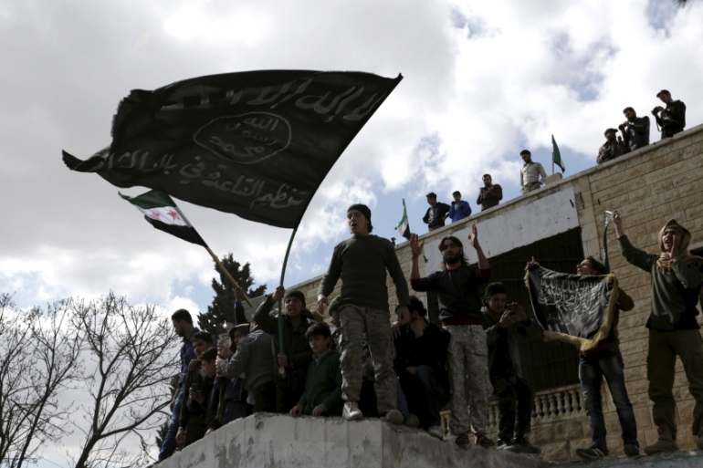 Al-Nusra Front fighters reportedly going door to door arresting US-backed rebels [Khalil Ashawi/Reuters]