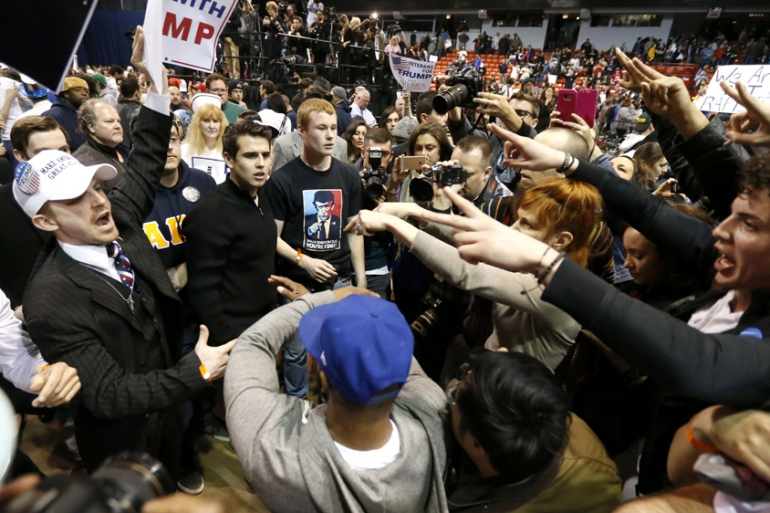 Donald Trump supporters and protesters clash on Friday March 11 in Chicago [Charles Rex Arbogast/AP]