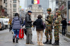 Troops on patrol in central Brussels following Tuesday''s bomb attacks [Vincent Kessler/Reuters]