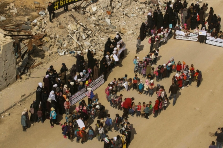The children in the protest in Darayya lined-up to form the letters 'SOS' [Local Council of Darayya]