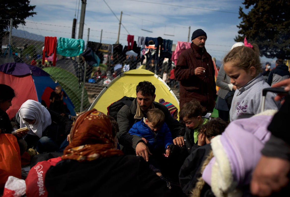 Around 13,000 people, mostly from the Middle East and African nations, are believed to be stranded in Idomeni, awaiting a chance to proceed with their journey towards Germany and other northern European countries. [Paulo Nunes dos Santos/Al Jazeera]