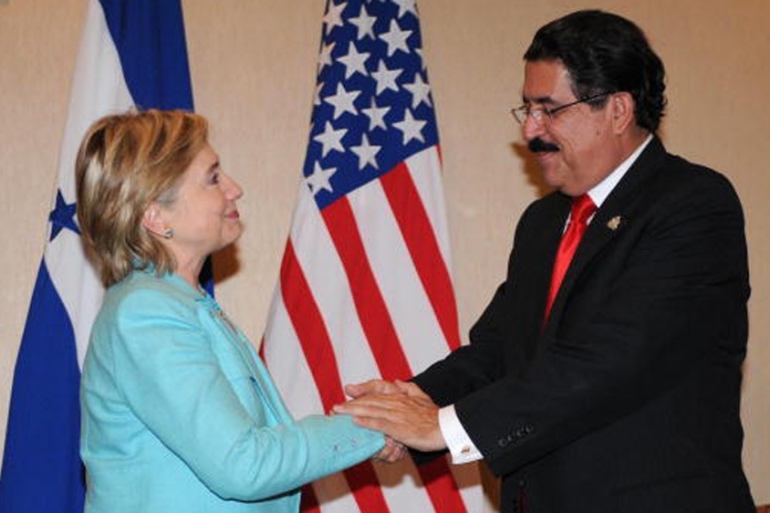 Honduras President Manuel Zelaya shakes hands with then US Secretary of State Hillary Clinton in 2006 [AFP]