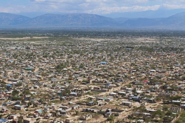 The sprawling settlement on the outskirts of Port-au-Prince is now divided into 14 informal boroughs, including one called Jerusalem [Stephanie Ott/Al Jazeera]