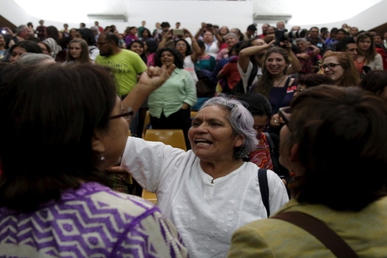 People react after the verdict in the Sepur Zarco case in Guatemala City [REUTERS/Josue Decavele]