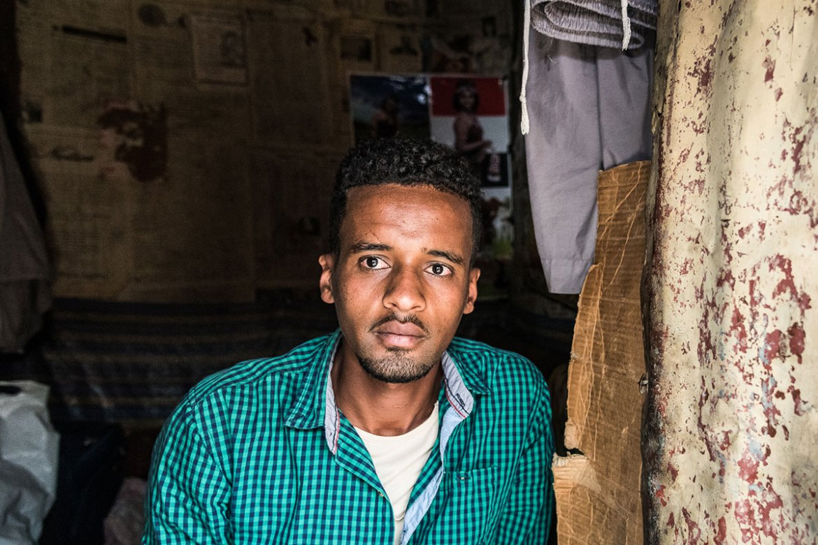 'I would leave even tonight, if I had money,' says Camil, 27. He arrived in Addis Ababa three years ago and has applied for a residency visa. He is trying to save money to cross the desert and the sea. [Stefania Prandi/Al Jazeera]