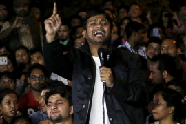 Kumar addresses students inside the JNUcampus after being released on bail from a Delhi prison [Anindito Mukherjee/Reuters]