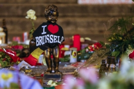 A replica of the Manneken Pis statue is seen among flowers at a memorial for the victims of bomb attacks in Brussels [Reuters]