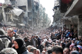 Palestinian Yarmouk refugee camp in Syria in 2014; though the difficulties are the same, Palestinian Syrians' asylum applications are processed separately and are often prolonged [File: UNRWA via AP]