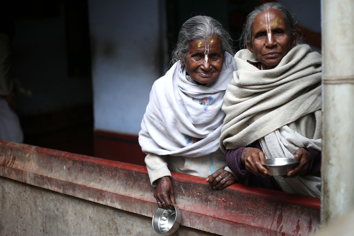Forced to leave their homes, these widows find solace in each other's company. They share rooms in the shelter and try to live like a family. The shelters are cramped with dingy rooms and become these women's homes for life. [Showkat Shafi/Al Jazeera]