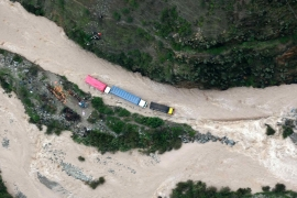 Trucks stranded on the flooded Central Highway after the Rimac River overflowed in the province of Huarochiri, Lima [EPA]