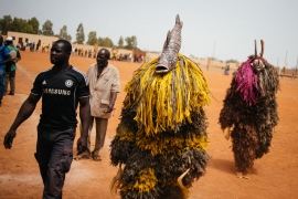 The identity of the person behind the mask is always kept secret. Fibre masks from Lery village. [Jacob Balzani Loov/Al Jazeera]