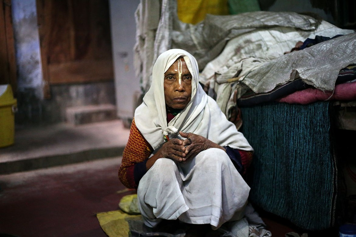 Maya Rani, 80, says: 'I have no one in this world. I am all alone. Being a widow is the biggest curse for a woman. Throughout my life, I have longed for respect and some dignity.' [Showkat Shafi/Al Jazeera]