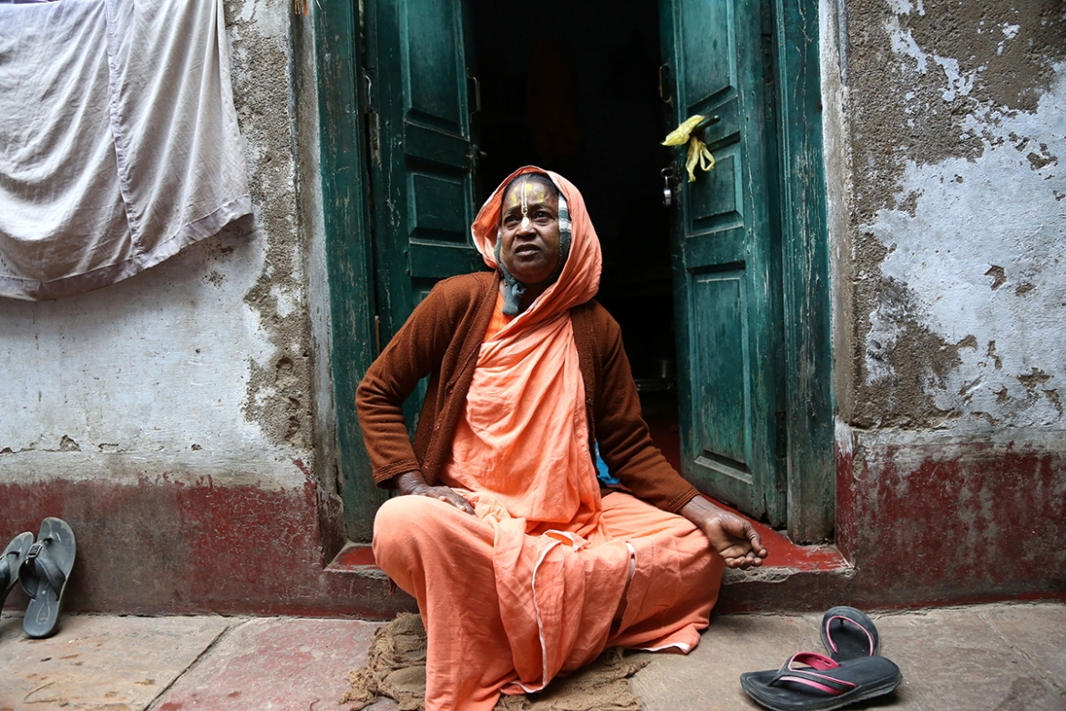 'I was 18 when my husband died. I was thrown out of the house by my in-laws because they feared that I would demand a share in the ancestral property,' said Arti Mistri, who is now 65 years old. 'Even my own brother didn't want me to live with his family because widows bring bad luck. Vrindavan was my last refuge.' [Showkat Shafi/Al Jazeera]