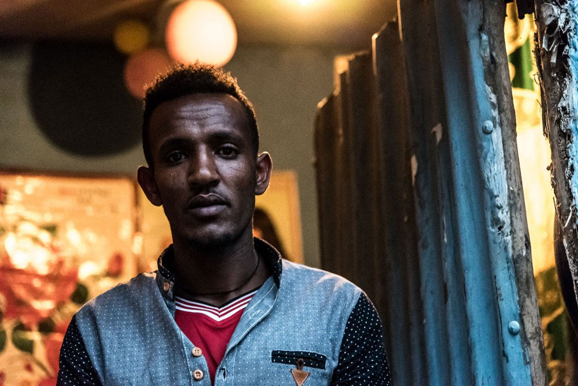 Birhanu left Keren, the second largest city in Eritrea, because he was forced to serve in the army, for which he was paid only $8 a month. He is not sure where to go next as he has no relatives in Europe and no money to pay for his journey. [Stefania Prandi/Al Jazeera]