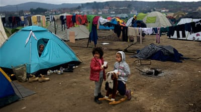 Syrian children play outside a tent at the Greek-Macedonian border station of Idomeni, Greece. [Paulo Nunes dos Santos/Al Jazeera]
