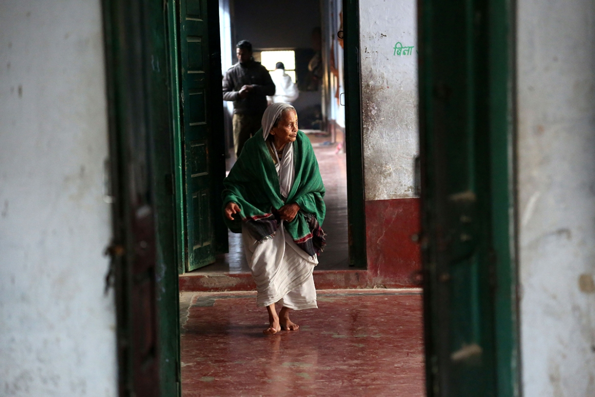 'My husband died. I had one son and three daughters. I left them with my parents as I didn't want them to suffer because of me,' 90-year-old Lolita Debnath remembered. 'Everybody taunts widows. In all these years, my son came just once to see if I was alive.' [Showkat Shafi/Al Jazeera]