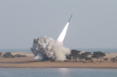 A new multiple launch rocket system is test fired in Pyongyang [REUTERS]