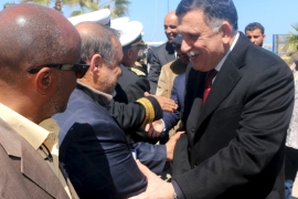 Libya's new UN-backed government issues warning