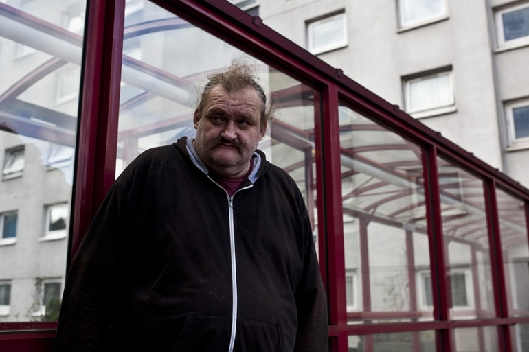 'Big Dave' lives in a tower that provides social housing for hundreds of people. He was previously homeless for seven years [David Shaw/Al Jazeera]