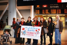 A 'welcoming committee' of the Toronto chapter of Save a Family from Syria, a multifaith group working to bring Syrian refugee families to Canada [Lisa Jackson/Al Jazeera]