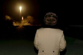 North Korean leader Kim Jong Un watches a ballistic rocket launch drill in March [Reuters]