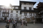 Japanese tourists visit the Kathmandu Durbar Square surrounded by supported wooden poles, Kathmandu, Nepal [EPA]