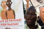 Protesters shout slogans as they hold placards during a demonstration in Rabat against racism in Morocco in 2014 [AFP]