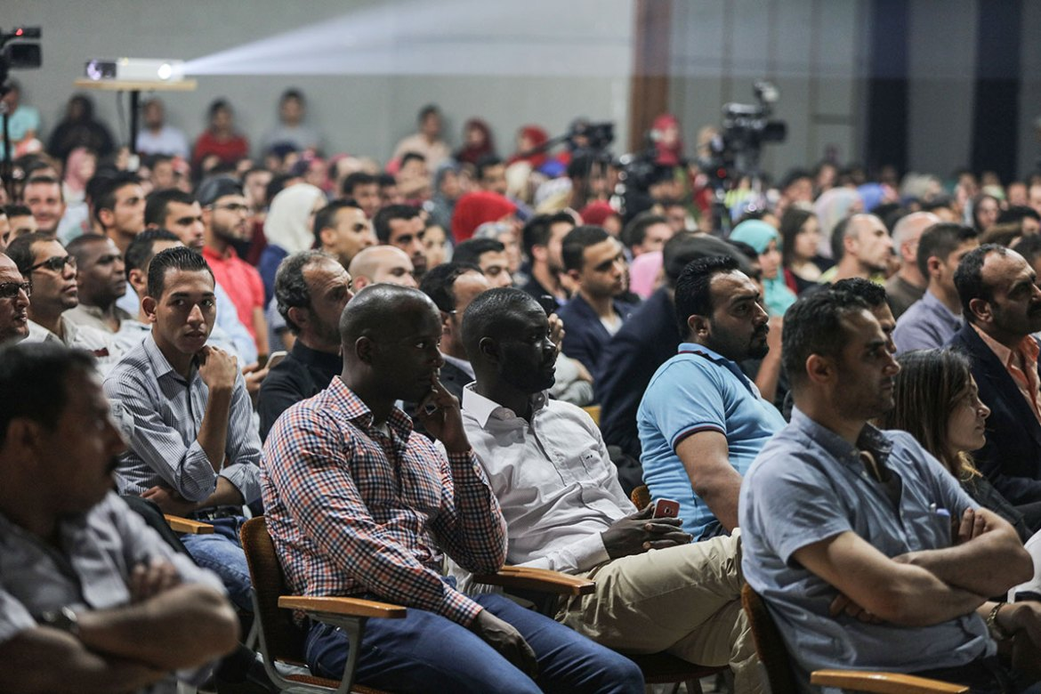 Mamadou, centre, an official with the Red Cross, attends a screening. [Wissam Nassar/Al Jazeera]