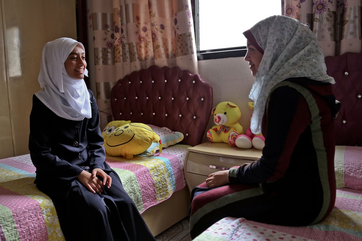 Nofal shares a bedroom with her 20-year-old sister. She is the youngest of four girls, and though none of them are athletes, they all support her and often ride in the car with their father. [Lena Odgaard/Al Jazeera]