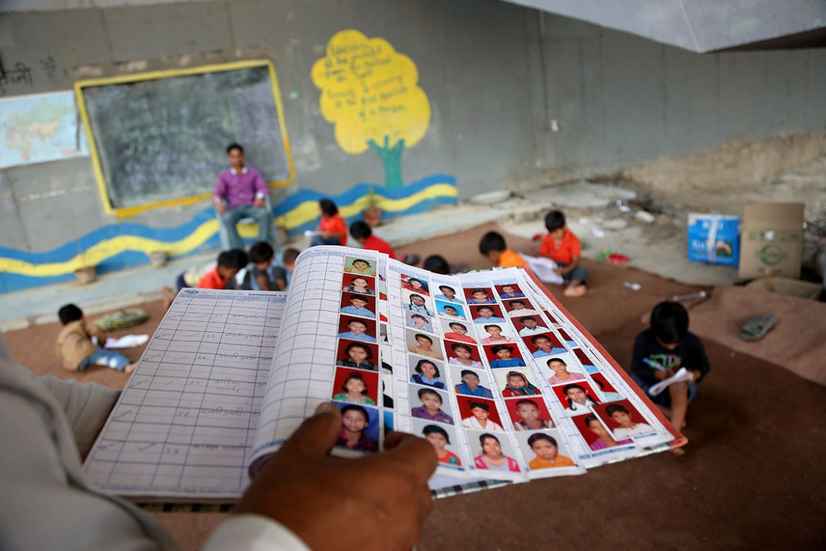 Each pupil who attends the school is formally registered with their name and photograph. [Showkat Shafi/Al Jazeera]