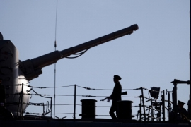 A Russian sailor stands guard on the deck of a Russian nuclear-powered missile cruiser docked in the Cypriot port of Limassol [AFP]