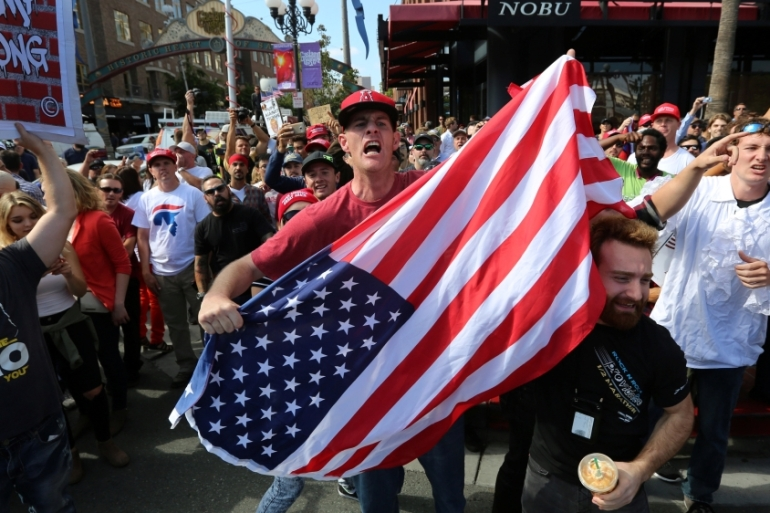 Supporters of Donald Trump shout at anti-Trump demonstrators outside a campaign event for Republican presidential candidate in San Diego, California on May 27 [Reuters]