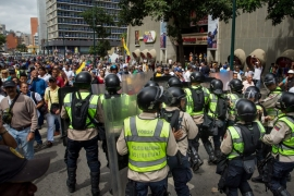 The demonstrations were the first major test of Maduro's state of emergency [EPA]