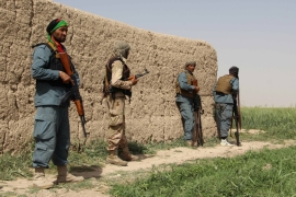 Afghan policemen keep watch during a battle with the Taliban in Nahr-e Saraj district [Abdul Malik/Reuters]