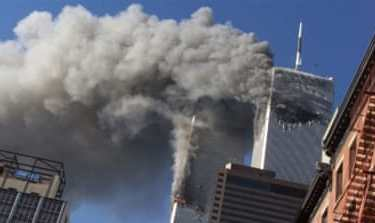 In this Sept. 11, 2001 file photo, smoke rising from the burning twin towers of the World Trade Center after hijacked planes crashed into the towers, in New York City. Every American of a certain age has a 9/11 story _ vivid memories of where they were, what they saw, how they felt on that awful day. Donald Trump is one of them. And for New Yorkers like him, 9/11 melds first-hand experience with what they felt in their guts, what they saw on television and what was playing out in the lives of friends and loved ones in a city under siege. (AP Photo/Richard Drew, File)